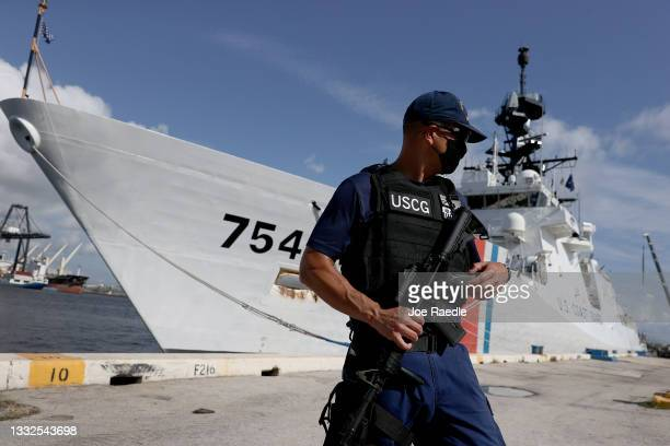 United States Coast Guard crew member stands guard near the Cutter James before drugs are offloaded at Port Everglades on August 05, 2021 in Port...