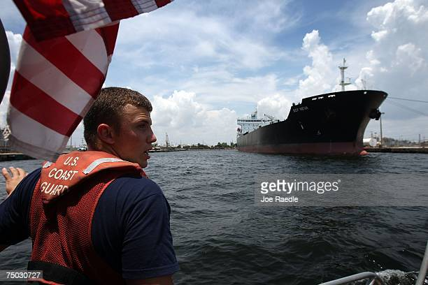 United States Coast Guard E3 Tim Myerson patrols in the water off of Port Everglades July 4 2007 in Fort Lauderdale Florida Across the nation people...