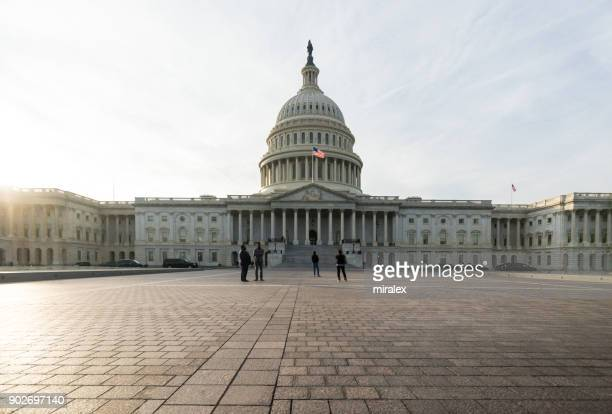 united states congress building lit by setting sun, washington, d.c. usa - congress stock pictures, royalty-free photos & images