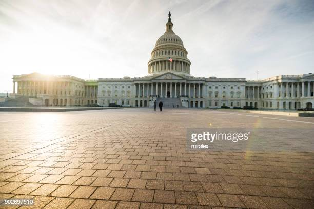 united states congress building lit by setting sun, washington, d.c. usa - united states congress stock pictures, royalty-free photos & images