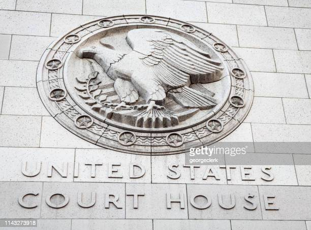 united states court house sign on stone wall - courthouse stock pictures, royalty-free photos & images