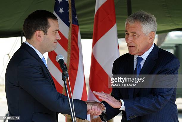 United States Defence Secretary Chuck Hagel shakes hands with Georgia's Defence Minister Irakly Alasania during an official welcoming ceremony in...
