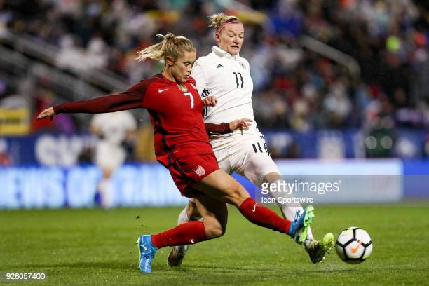 United States defender Abby Dahlkemper steals the ball from Germany forward Alexandra Popp during the first half of the international game between...