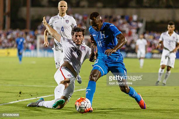 United States defender Brad Evans challenges an attacking Honduras midfielder Romell Quioto during the Group A CONCACAF Gold Cup stage match between...