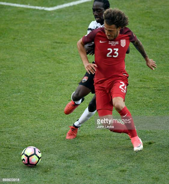 United States defender Fabian Johnson keeps the ball away from Trinidad Tobago defender Alvin Jones during the first half on June 8 2017 during a...