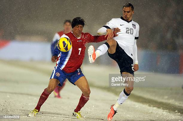 United States defender Geoff Cameron battles with Costa Rica midfielder Cristian Bolanos for the ball during the first half of a FIFA 2014 World Cup...