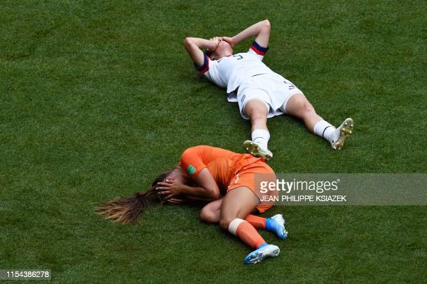 TOPSHOT United States' defender Kelley O'Hara and United States' defender Ali Krieger after a clash of heads during the France 2019 Womens World Cup...