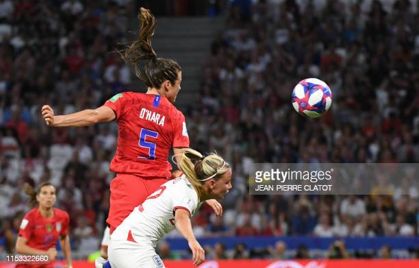 TOPSHOT United States' defender Kelley O'Hara jumps for the ball with England's forward Beth Mead during the France 2019 Women's World Cup semifinal...