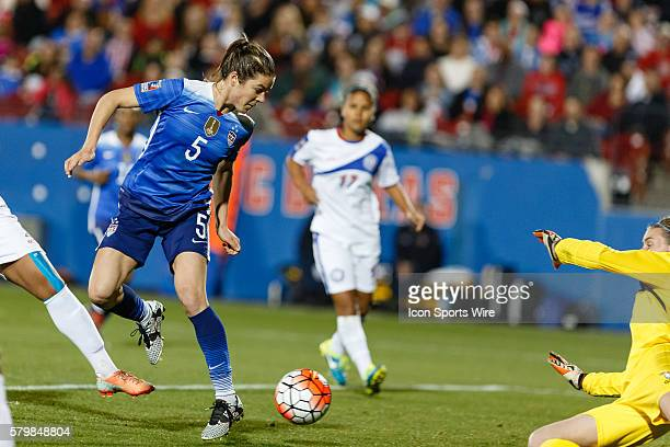 United States Defender Kelley O'Hara scores on a back heal shot during the Women's Olympic Soccer Qualifying group stage match between the United...