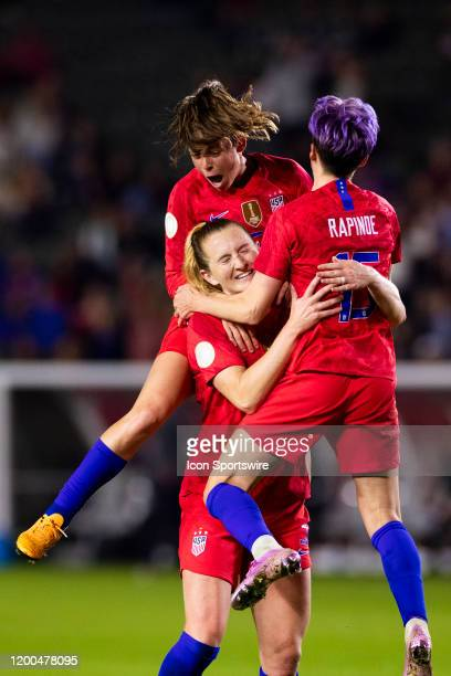 United States defender Kelley O'hara United States forward Megan Rapinoe and United States midfielder Samantha Mewis celebrate a goal during the...