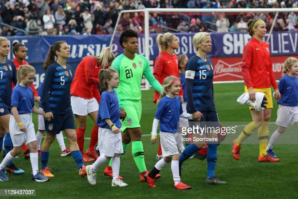 United States defender Kelley O'Hara United States goalkeeper Adrianna Franch and United States midfielder Megan Rapinoe lead the team onto the field...