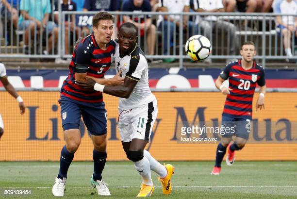 United States defender Matt Besler and Ghana forward Raphael Dwamena hold each other back from the ball during an international friendly between the...