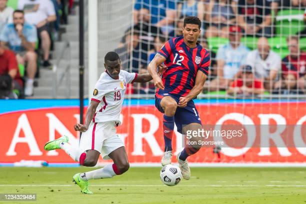United States defender Miles Robinson attempts to avoid the tackle of Qatar forward Al Moez Ali during the Gold Cup semifinal match between the...