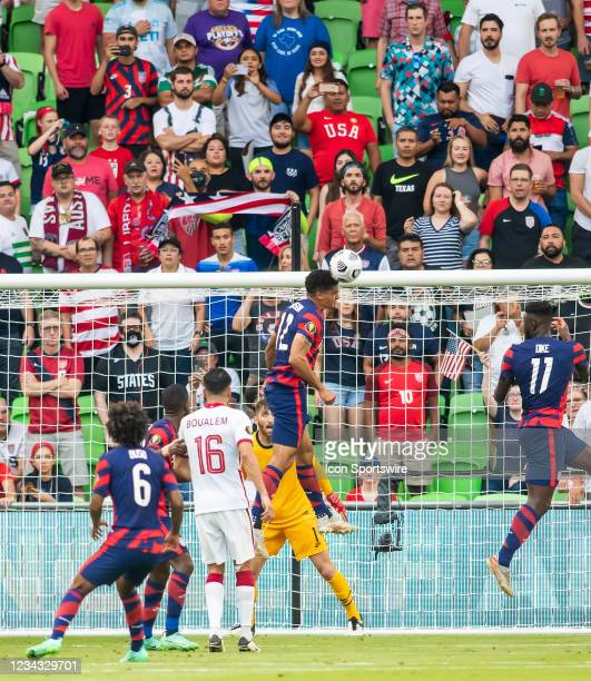 United States defender Miles Robinson heads the ball away from goal in front of spectators during the Gold Cup semifinal match between the United...