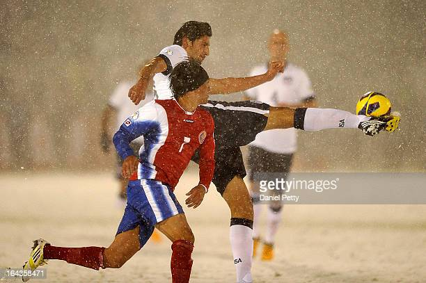 United States defender Omar Gonzalez kicks the ball against Costa Rica midfielder Cristian Bolanos during a FIFA 2014 World Cup Qualifier game at...