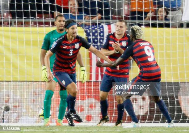 United States defender Omar Gonzalez reacts after scoring a goal against Martinique as teammates Jordan Morris and Gyasi Zardes join the celebration...