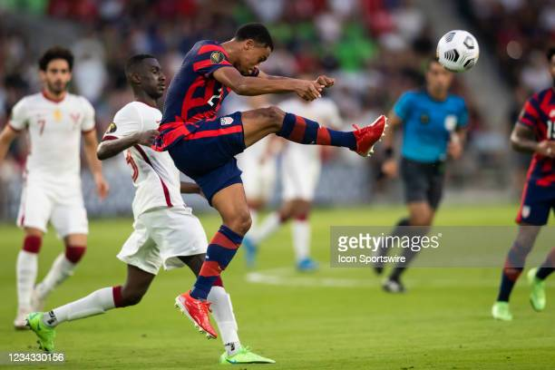 United States defender Reggie Cannon kicks the ball away from the opposing side during the Gold Cup semifinal match between the United States and...