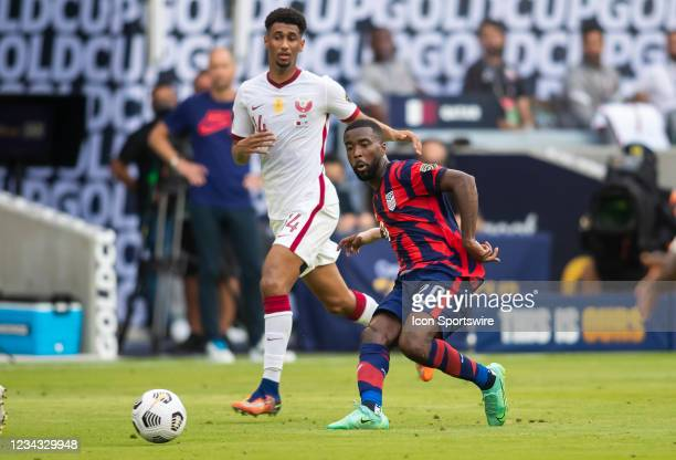 United States defender Shaq Moore slots a ball a ball to a teammate during the Gold Cup semifinal match between the United States and Qatar on...