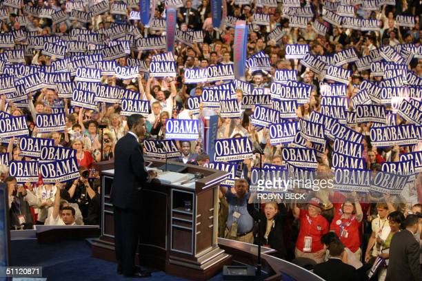 Democratic National Convention keynote speaker Barack Obama US Senate candidate for Illinois is greeted by delegates 27 July in Boston Massachusetts...