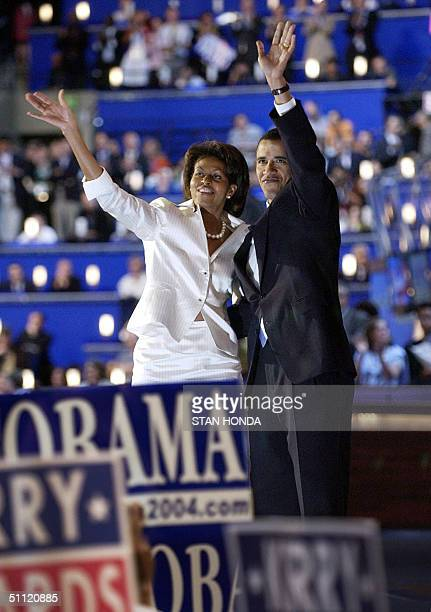 Democratic National Convention keynote speaker Barack Obama and his wife Michelle wave after he spoke 27 July in Boston Massachusetts The US...