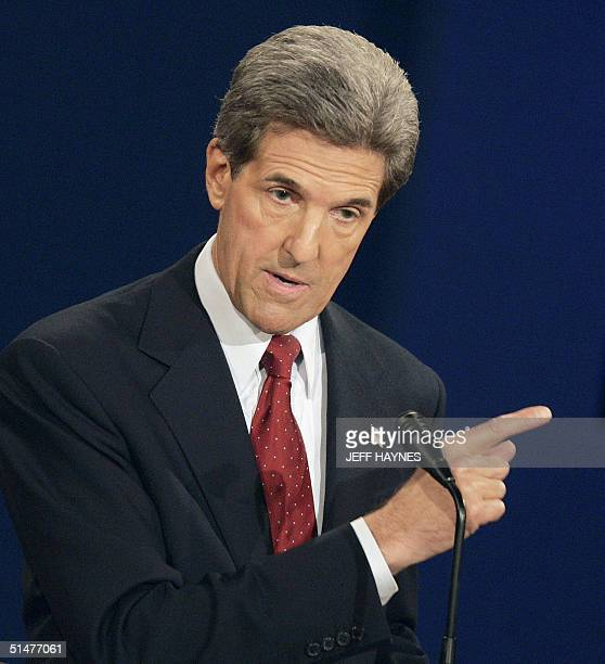 Democratic presidential candidate John Kerry points at US President George W Bush during their final televised debate 13 October 2004 at Gammage...