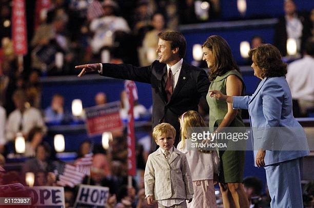 Democratic vice presidential candidate John Edwards is joined by his wife Elizabeth daughters Catharine and Emma Claire back to the camera and son...