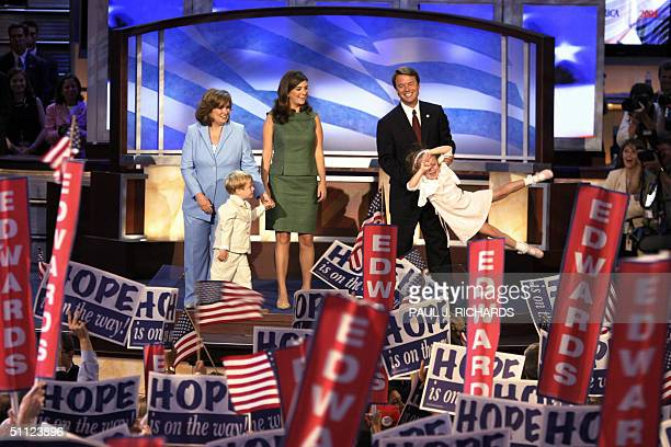 Democratic vice presidential candidate John Edwards swings his daughter Emma Claire as the the Democratic National Convention cheers his family vwife...