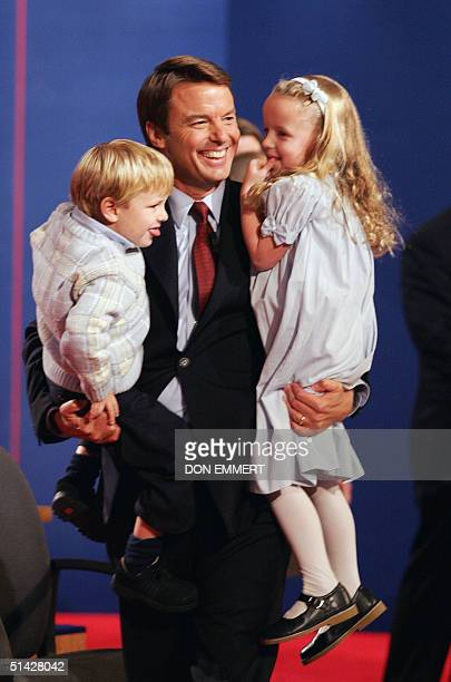 Democratic vicepresidential candidate John Edwards carries his son Jack and daughter Emma Claire following his face off debate with US VicePresident...