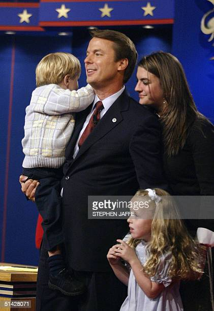 Democratic vicepresidential candidate John Edwards faces the audience carrying his son Jack and flanked by his daughters Emma Claire and Catharine...