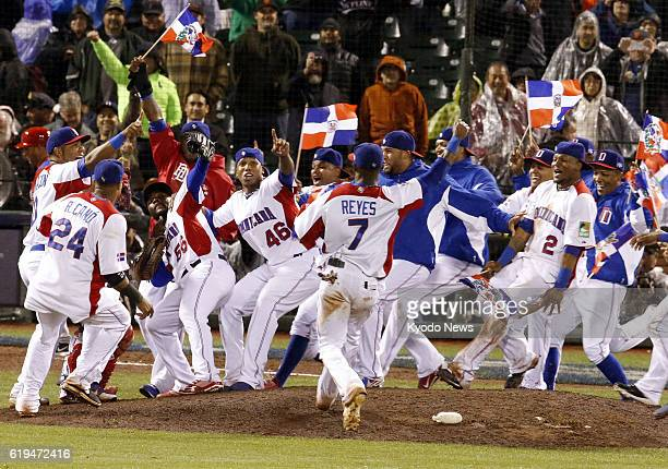 SAN FRANCISCO United States Dominican Republic players run to the mound after beating Puerto Rico 30 to win their first World Baseball Classic title...