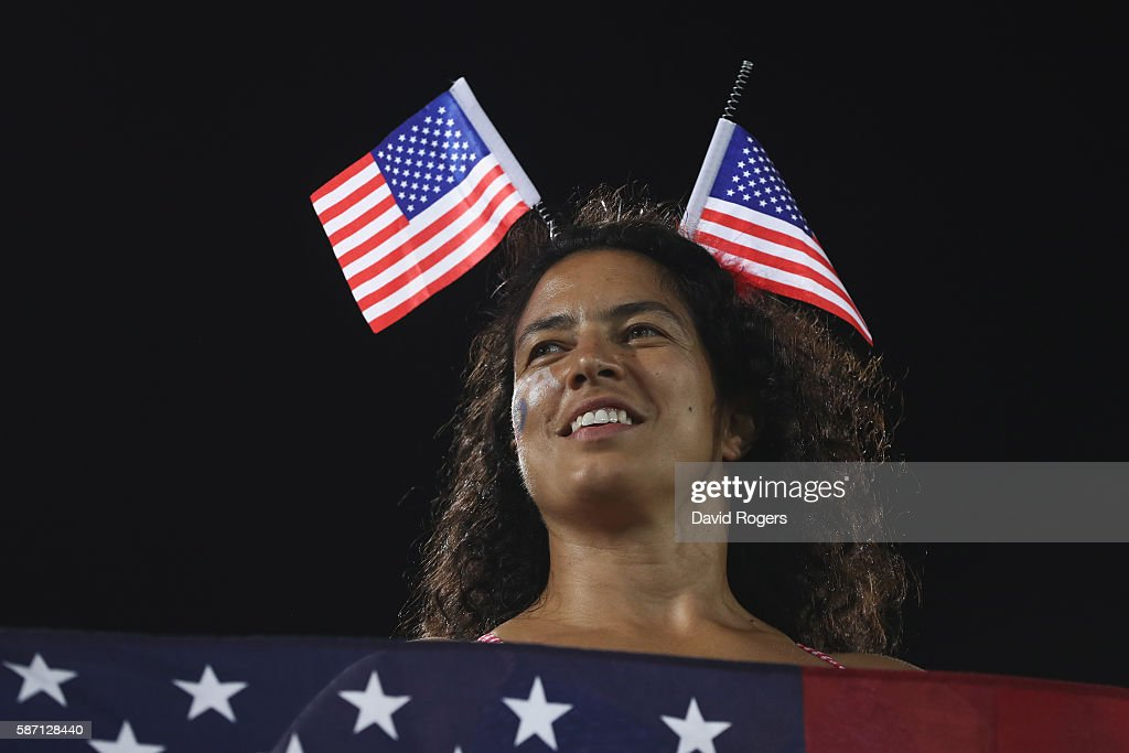 A United States fan shows off flags prior to the United States taking on New Zealand during the Women's Quarterfinal rugby match on Day 2 of the Rio 2016 Olympic Games at Deodoro Stadium on August 7, 2016 in Rio de Janeiro, Brazil.
