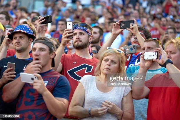 United States fans all watch and record video and pictures with their cell phones during a CONCACAF Gold Cup Group B match between the United States...
