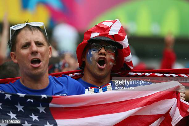 United States fans cheer in the rain prior to the 2014 FIFA World Cup Brazil group G match between the United States and Germany at Arena Pernambuco...