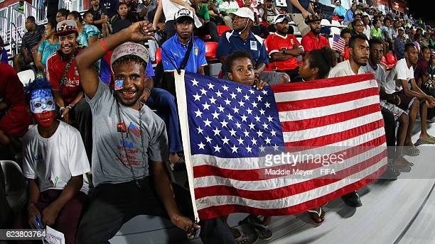 United States fans hold the American flag before the Group C match of the FIFA U20 Women's World Cup Papua New Guinea 2016 between United States and...
