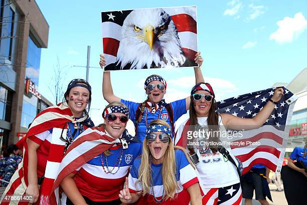United States fans pose outside the stadium before the match against China in the FIFA Women's World Cup 2015 Quarter Final match at Lansdowne...