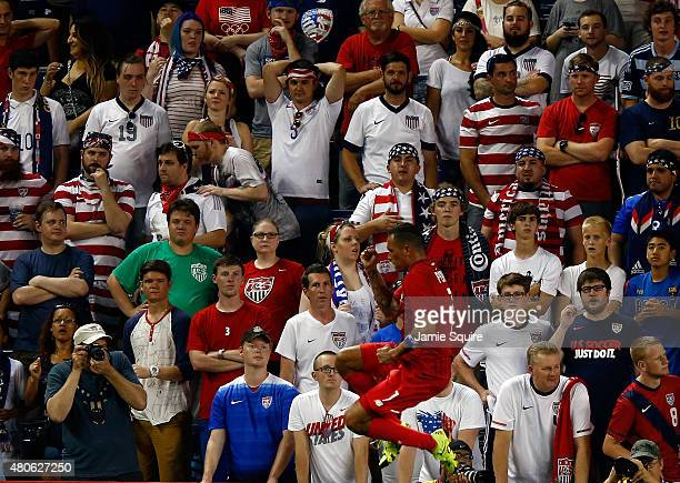 United States fans watch in shock as Blas Perez of Panama celebrates after scoring a goal during the 1st half of the CONCACAF Gold Cup match between...