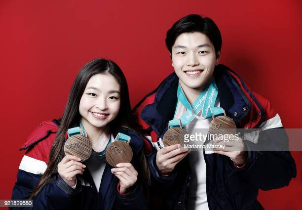 United States Figure skaters and siblings Maia Shibutani and older brother Alex Shibutani pose for a portrait with their bronze medals one for the...
