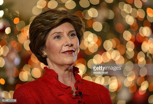 United States First Lady Laura Bush talks to the press in front of a Christmas tree in the East Room of the White House Mrs Bush hosted a press...