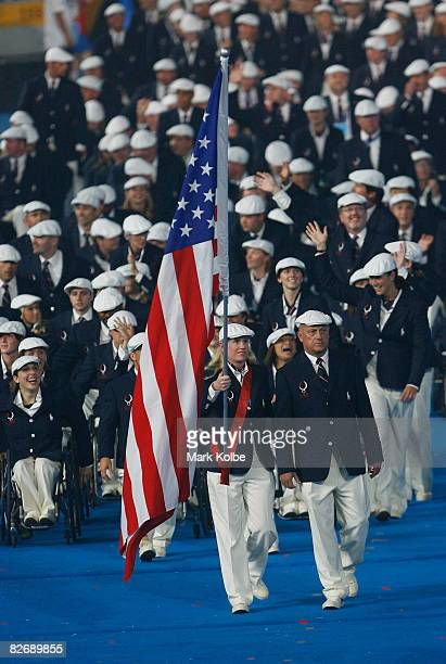 United States flag bearer Jennifer Armbruster leads the team during the entrance of athletes at the Opening Ceremony for the 2008 Paralympic Games at...