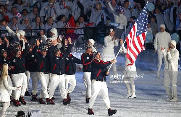 United States flag bearer Mark Grimmette leads in the US Olympic team during the Opening Ceremony of the 2010 Vancouver Winter Olympics at BC Place...