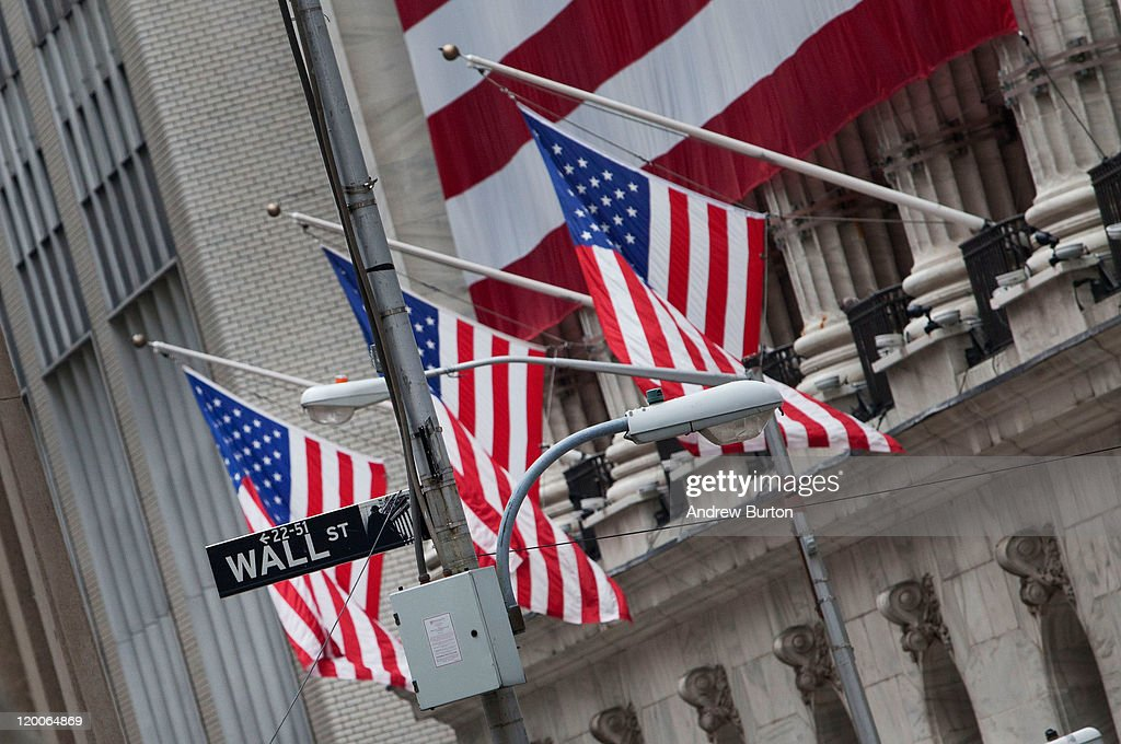 United States flags are seen on the outside of the New York Stock Exchange on July 29, 2011 in New York City. Bankers and economists were invited to meet with Treasury Department officials at the Federal Reserve Bank of New York today to discuss the on-going debt-limit crisis and how it could effect markets.