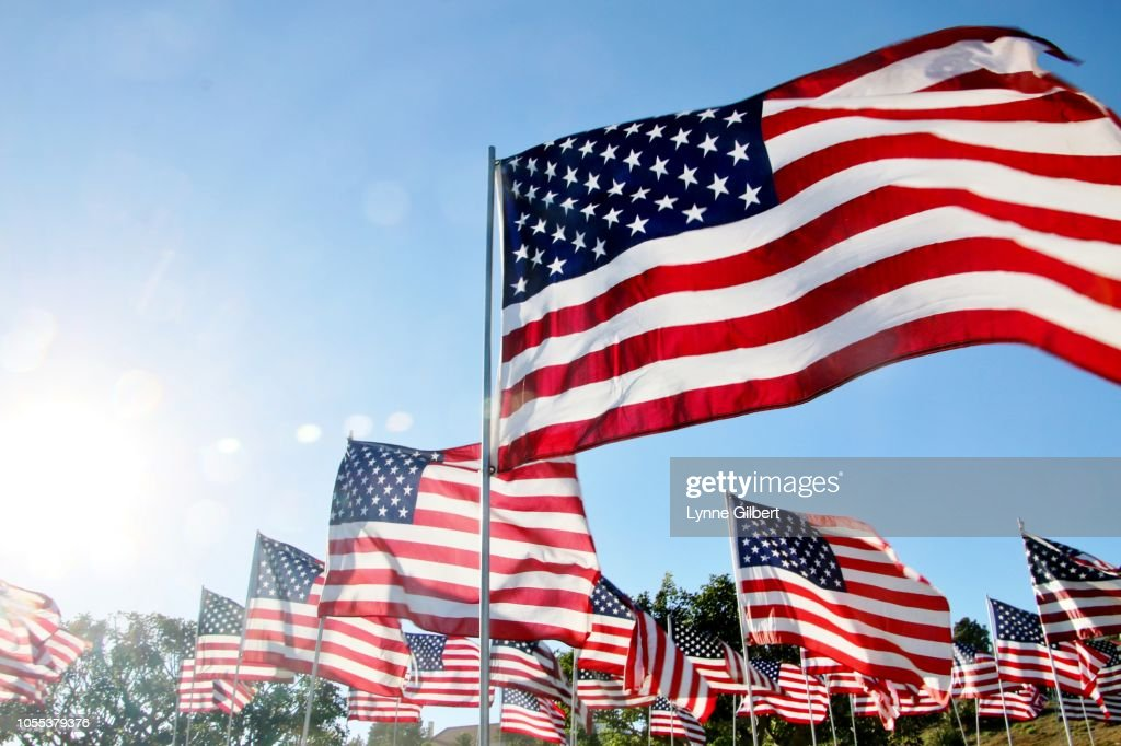 United States flags blow in the wind in Malibu, CA : Stock Photo