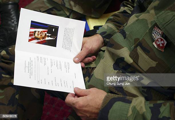 United States Forces Korea soldier attends a service for late US President Ronald Reagan in a chapel at a US army base on June 11 2004 in Seoul South...