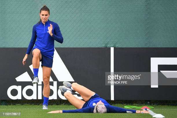 United States' forward Alex Morgan and forward Megan Rapinoe take part in a training session in Lyon on July 1 during the France 2019 football...