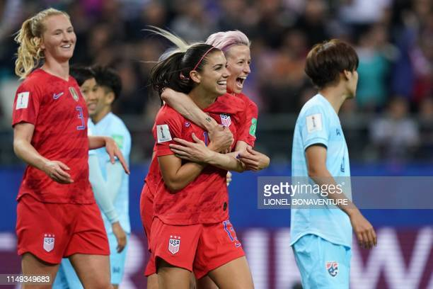 TOPSHOT United States' forward Alex Morgan and United States' forward Megan Rapinoe celebrate a goal during the France 2019 Women's World Cup Group F...