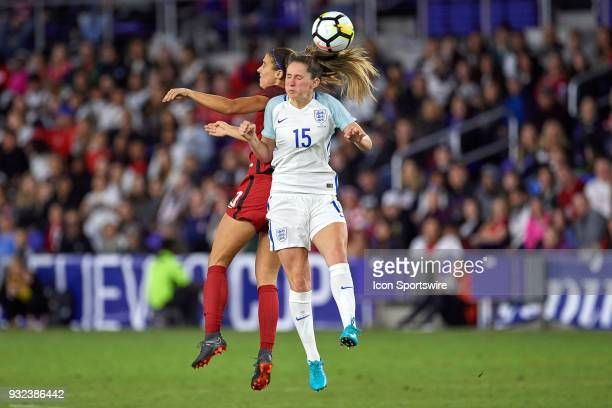 United States forward Alex Morgan battles with England defender Abby McManus for a header during the SheBelieves Cup match between USA and England on...