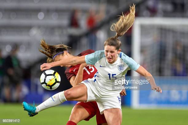 United States forward Alex Morgan battles with England defender Abby McManus for a loose ball during the SheBelieves Cup match between USA and...