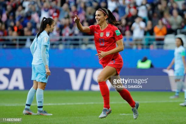 TOPSHOT United States' forward Alex Morgan celebrates after scoring a goal during the France 2019 Women's World Cup Group F football match between...