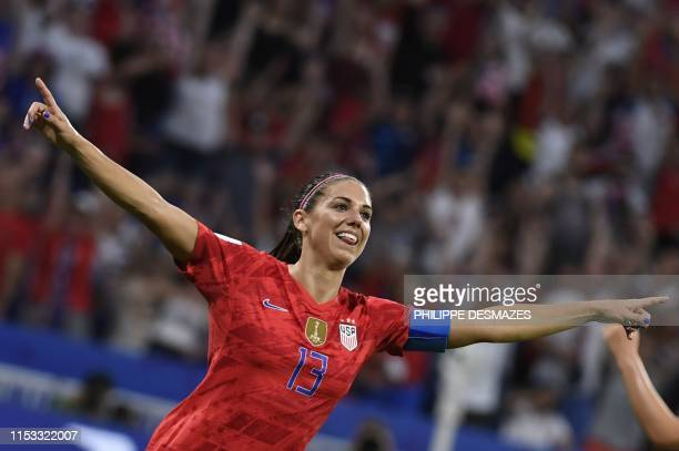 TOPSHOT United States' forward Alex Morgan celebrates after scoring a goal during the France 2019 Women's World Cup semifinal football match between...