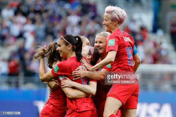 United States' forward Alex Morgan celebrates with teammates after scoring a goal during the France 2019 Women's World Cup Group F football match...